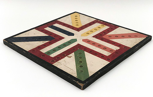 Vibrant Parcheesi Antique Wooden Gameboard on White Ground Yellow Red Blue Green