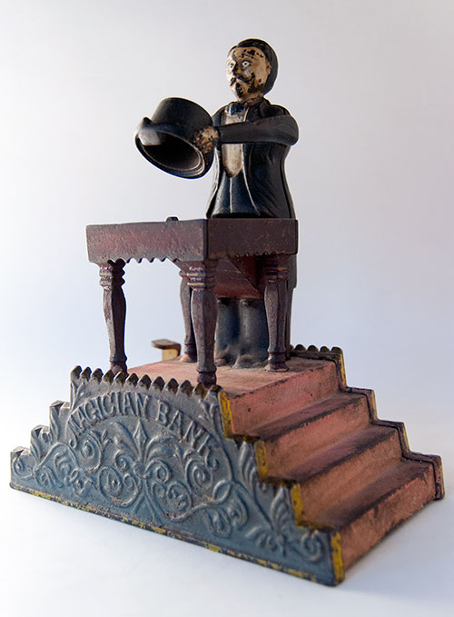 Magician Antique Cast Iron Mechanical Bank in All Original Paint