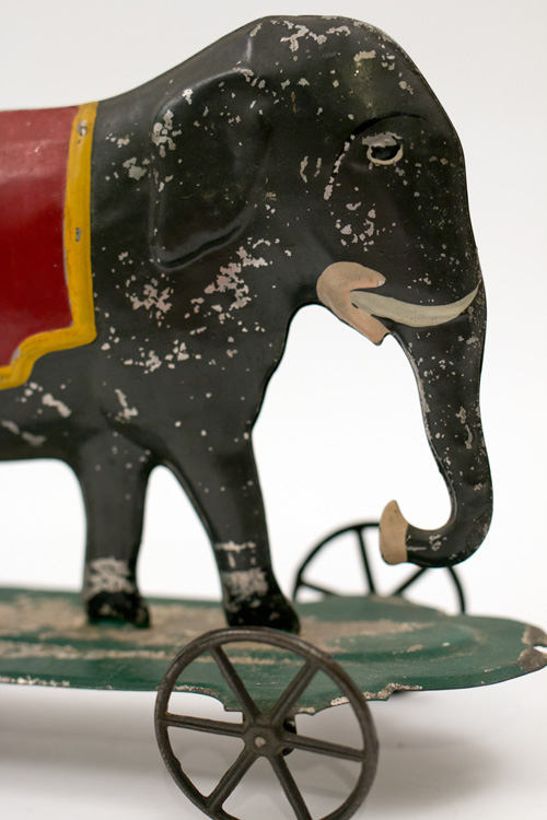 Early American Antique Painted Tin Toy Elephant on Base with Wheels