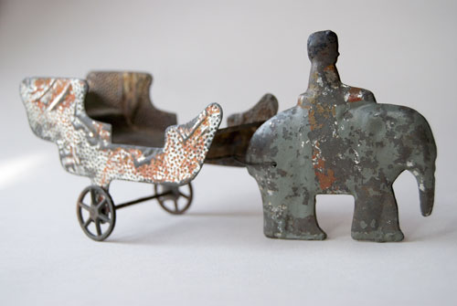 Early American Tin 19th Century Animal Drawn Wagon Elephant Rider Original Painted Surface Pull Toy For Sale