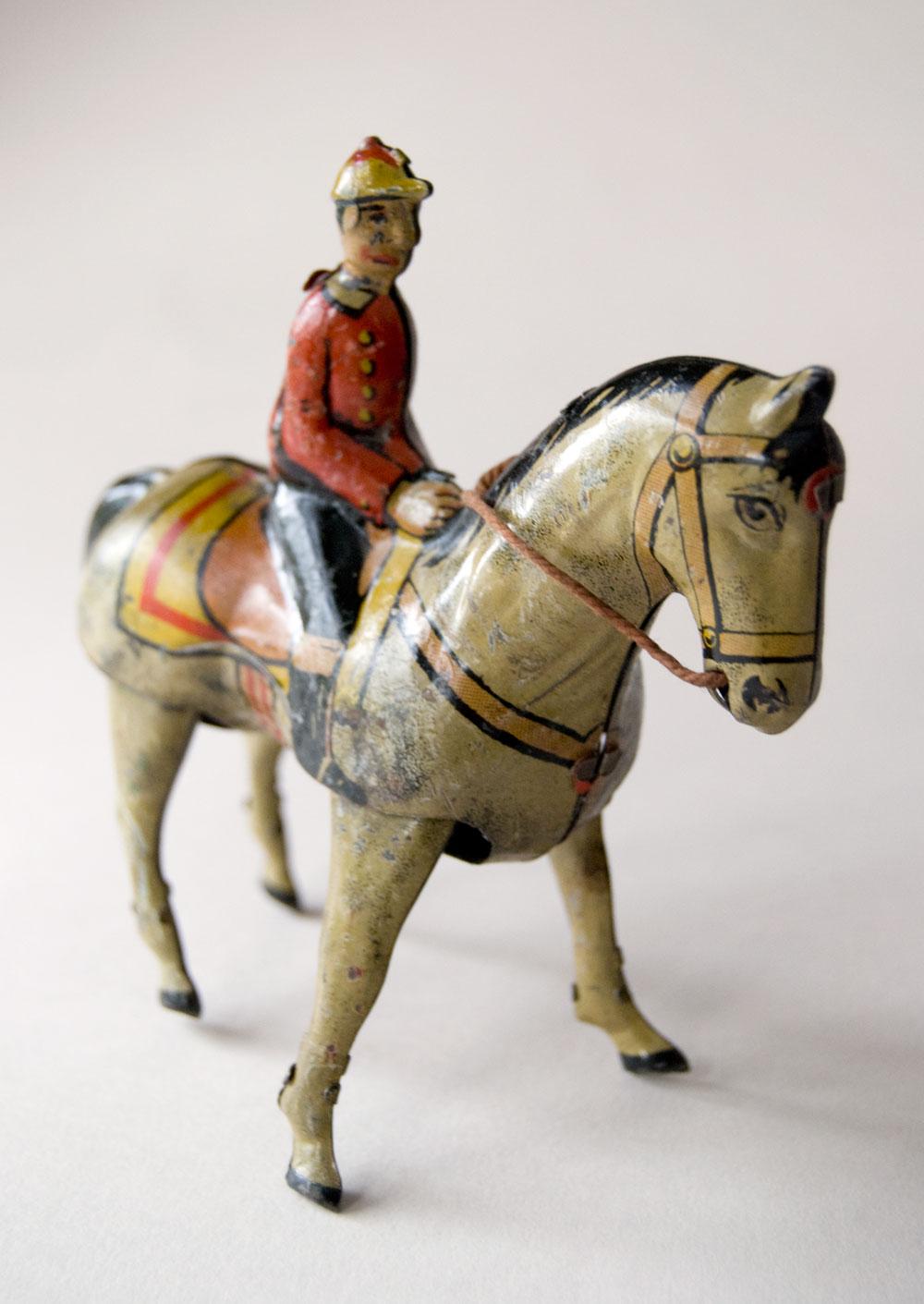 20th Century Toys : Antique tin litho wind up jockey on horse toy germany
