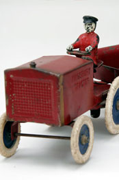 Kingsbury Tractor Red pressed steel, white and blue rubber tires and painted cast iron driver