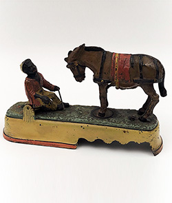 Antique Cast Iron Mechanical Bank Rare Yellow Base Variation Spise a Mule 19th Century Stevens Company for Sale