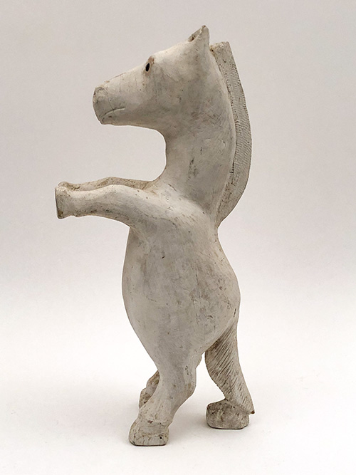 1976 folk art wooden carving of a white rearing horse by Silvio Zoratti American folk artist