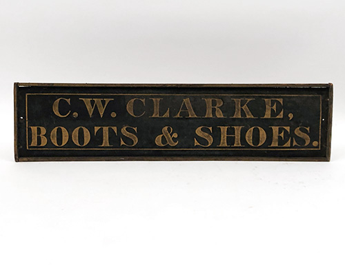 antique wooden boot and shoes trade sign c.w. clarke