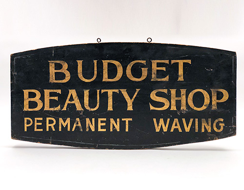 Black and gold antique wooden beauty shop trade sign